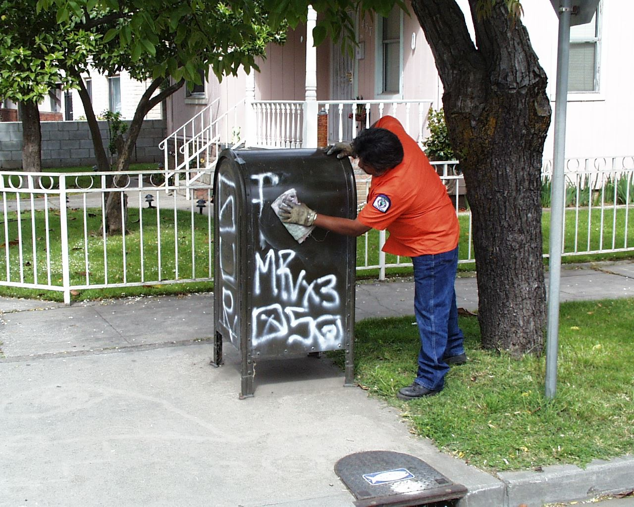 Man removing graffiti